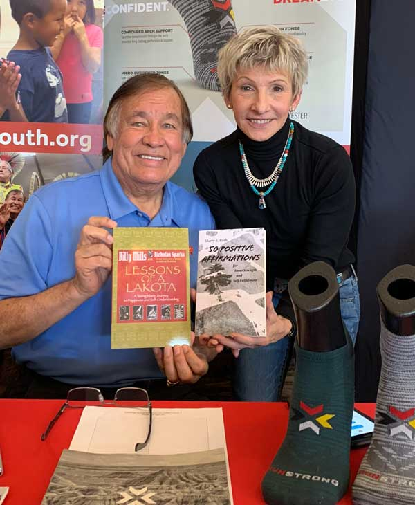 Sherry Kopko Ruth with 1964 Olympic gold medalist Oglala Lakota Billy Mills at a book signing event