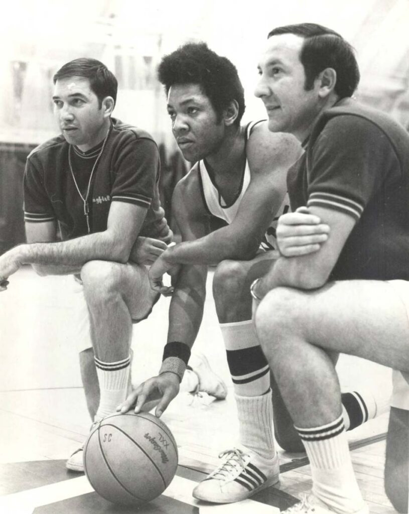 Captain Steve Waterman with head coach Ed Bilik, right, and assistant coach Ray Gilbert