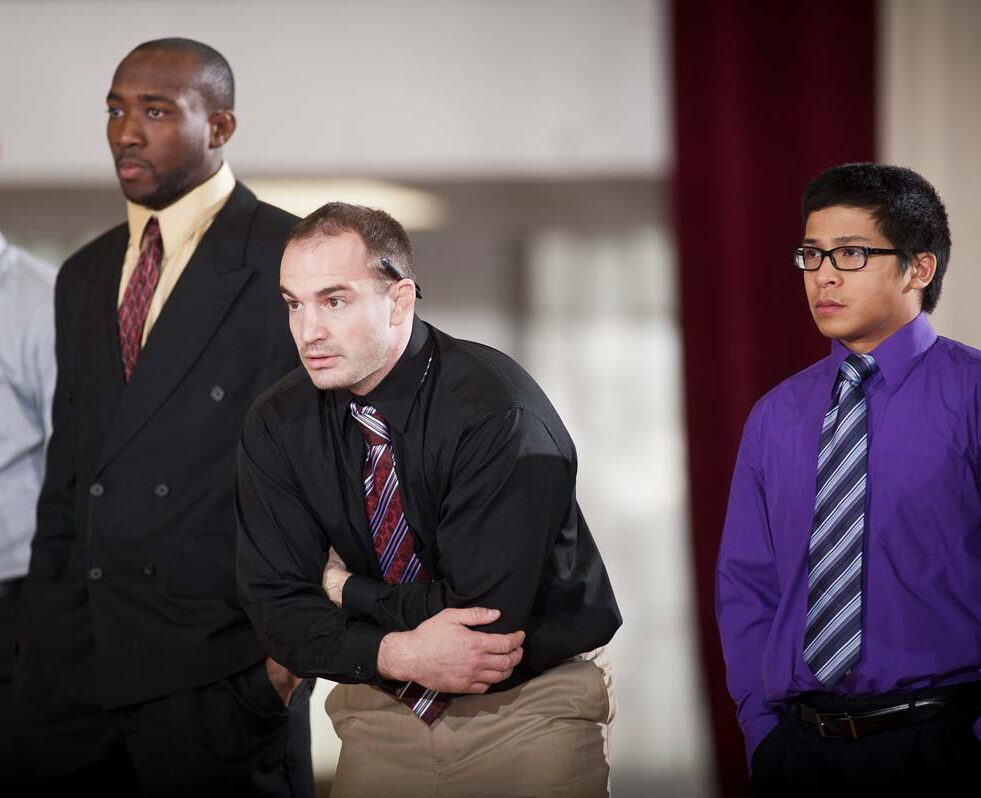 Wrestling head coach Jason Holder, center, with graduate assistants Marques Gales, left, and Pierre Bonduc