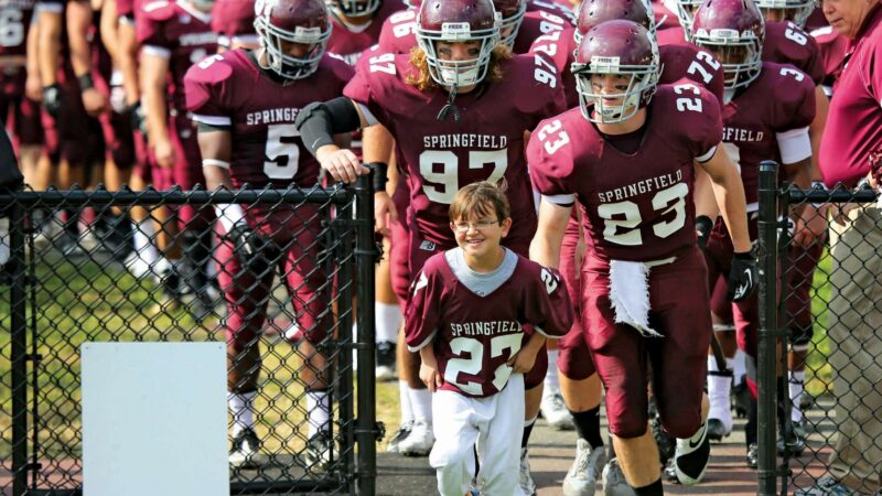 Springfield college football team with Friend